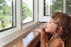 Young girl looking out of the window